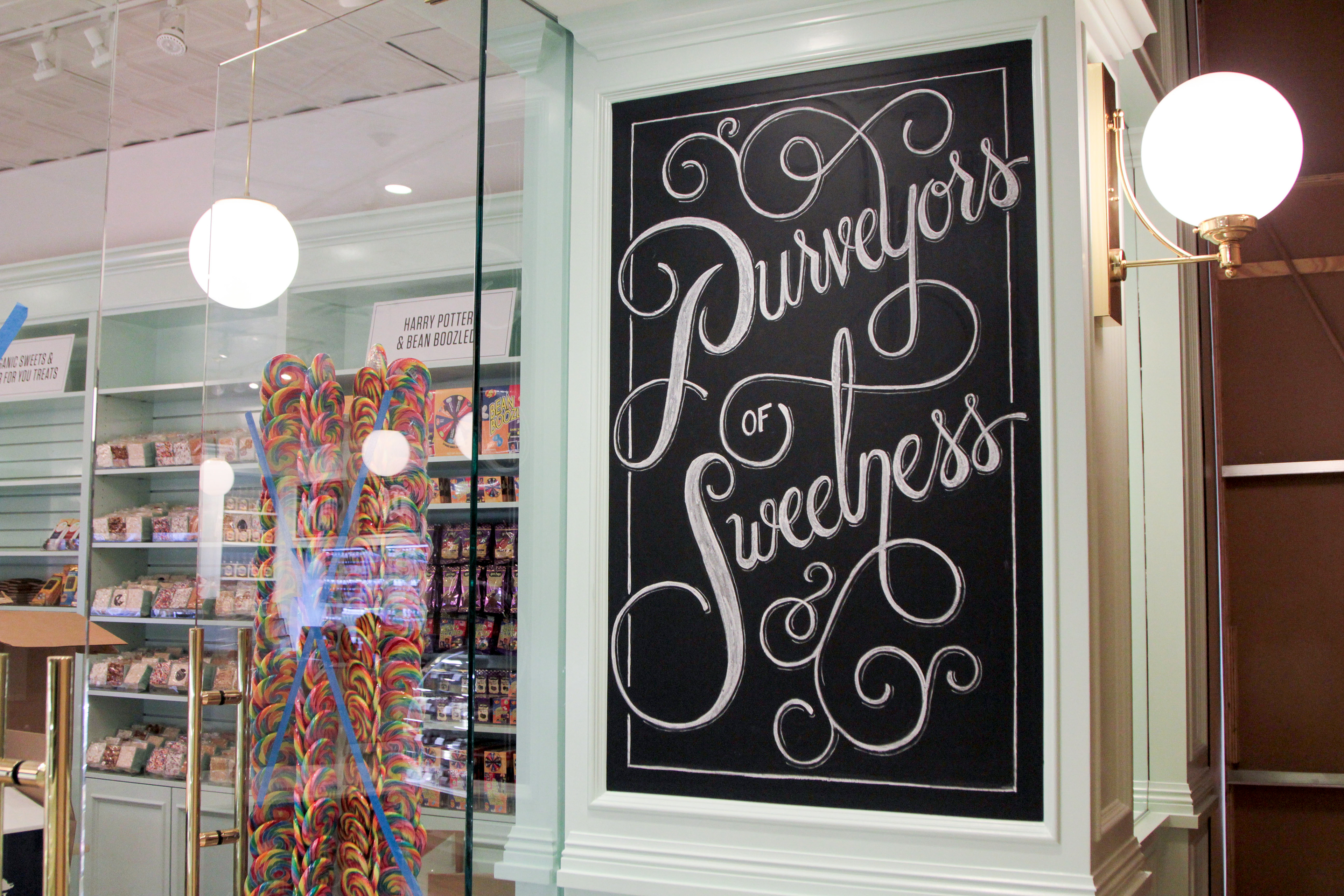 ryan lee a series of chalk wall murals for the lolli and pops candy store store in mission viejo ca